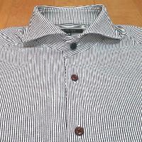 ミッシェルクランのストライプホリゾンタルカラーシャツのボタンです。